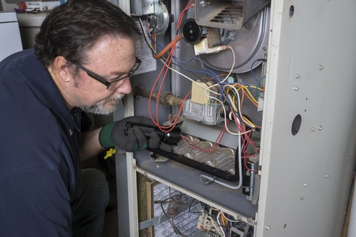 person-fixing-hvac-ars-appliance-repair